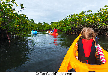 Family kayaking in mangroves - Family with kids paddling on...