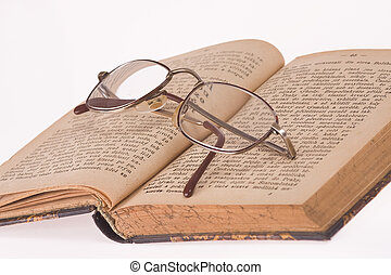 glasses and old book