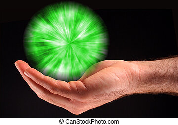 Green Ball of Light - A hand holding a green ball of light...