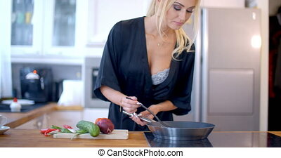 Pretty blond woman making the dinner with fresh farm...