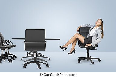 Busineswoman sitting on chair relaxing and looking at camera...