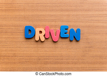 driven colorful word on the wooden background