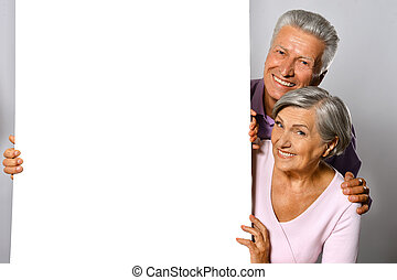 elderly couple posing - Portrait of an elderly couple posing...