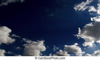 Contrast blue sky and running clouds timelapse footage