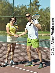 Tennis players near net - Tennis players standing near net...