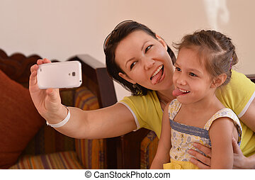 mother with her daughter - Happy mother with her daughter in...