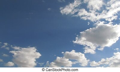 Summer sky timelapse. Clouds fast running over blue sky