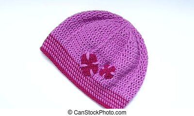 Girls Crochet hat - Purple crochet hat rotates on the table...