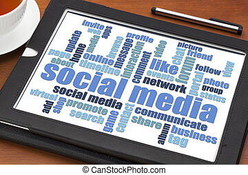social media word cloud on tablet - Social media concept -...