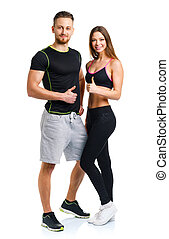 Athletic man and woman after fitness exercise with a finger...