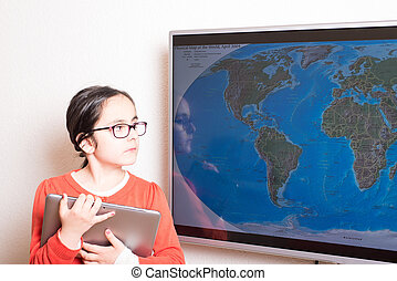 Tablet PC and interactive television - Little cute girl...