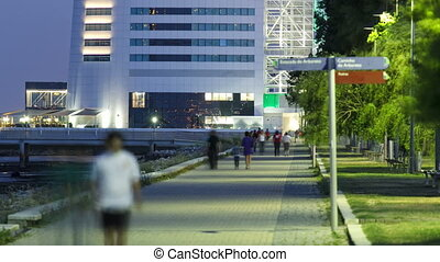 Walk near Hotel Tower in the Park of the Nations with...