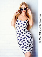 polkadot dress - Fashionable lady in polka-dot dress posing...