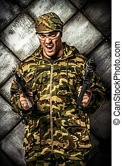 defend - Brave soldier in camouflage holding automatic...