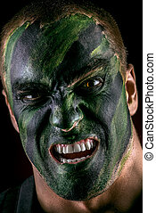 furious soldier - Close-up portrait of a furious soldier in...