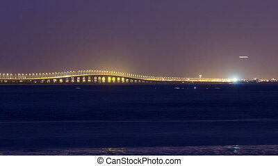 Vasco da Gama bridge in Lisbon by night, Portugal timelapse...