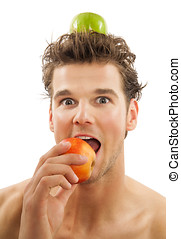 Man With Apple - Funny handsome young tanned fit man with...