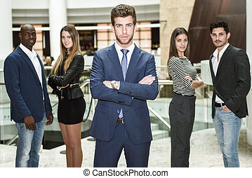 Businessman leader with arms crossed in working environment