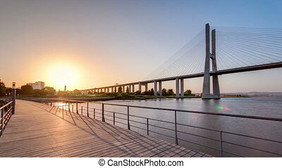 Vasco da Gama bridge during sunset and ebb-tide in Lisbon,...