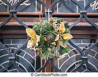 Christmas wreath on a window bar