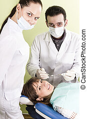 Dentist assistant and the patient are ready for treating teeth