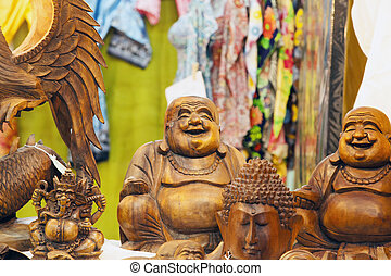 Smiling Buddah - Smiling wooden buddah statue between other...