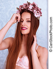 Pretty Woman in Bra with Rose Flowers on her Head