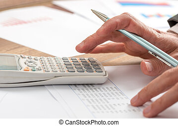 Accountant doing a calculation - Business accountant doing a...