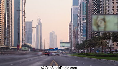 Buisness district of Dubai the Shiekh Zayed road at sunset time, UAE timelapse