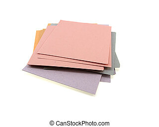 Pile of different multi-coloured office paper isolated on a...
