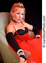sexy seductive mrs claus - Beautiful blonde sitting on...