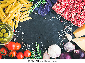 Pasta Bolognese ingredients: penne, minced meat, tomatoes, basil