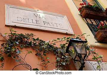 Via Delle Paste - street name sign in Rome, Italy with light...