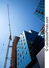 construction office building - crane over a construction...