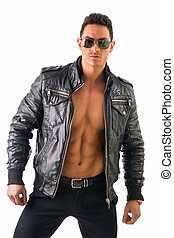 Handsome young man wearing leather jacket on naked torso,...