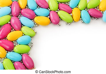 colored dragees - sugared almonds and silver spheres on...