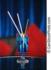 Blue cocktail on table in restaurant