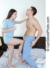 angry woman in panties kicking with leg handsome half naked...