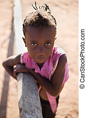 african girl living in a very poor community in a village...