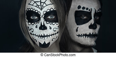 Loving couple with Halloween face art - Loving young couple...