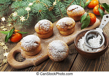 Muffins with sugar powder on the holiday table