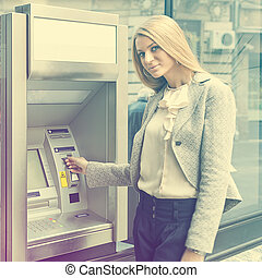 Young Woman use Bank ATM