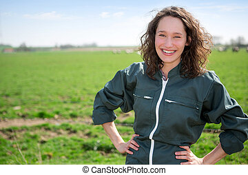 Portrait of a young attractive farmer in fields - View of a...
