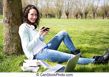 Young attractive woman realxing at the park - View of a...