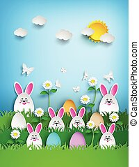 Easter background with eggs and rabbit in grass .