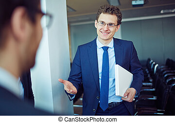 Friendly manager - Elegant employee in suit and eyeglasses...