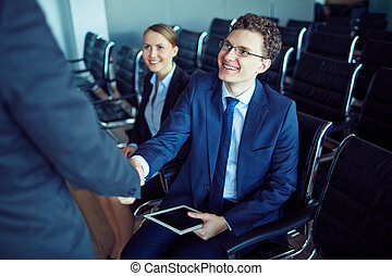 Meeting partner at conference - Male employee in suit and...