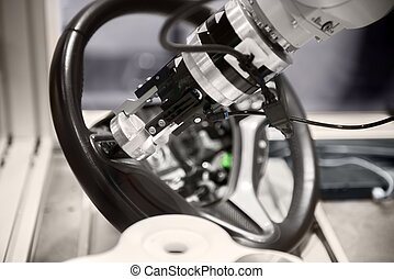 Robotic arm tearing down steering wheel - High technology...