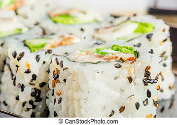 Japanese rolls with sesame seeds close-up shot
