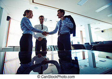 Business agreement - Two partners handshaking after signing...